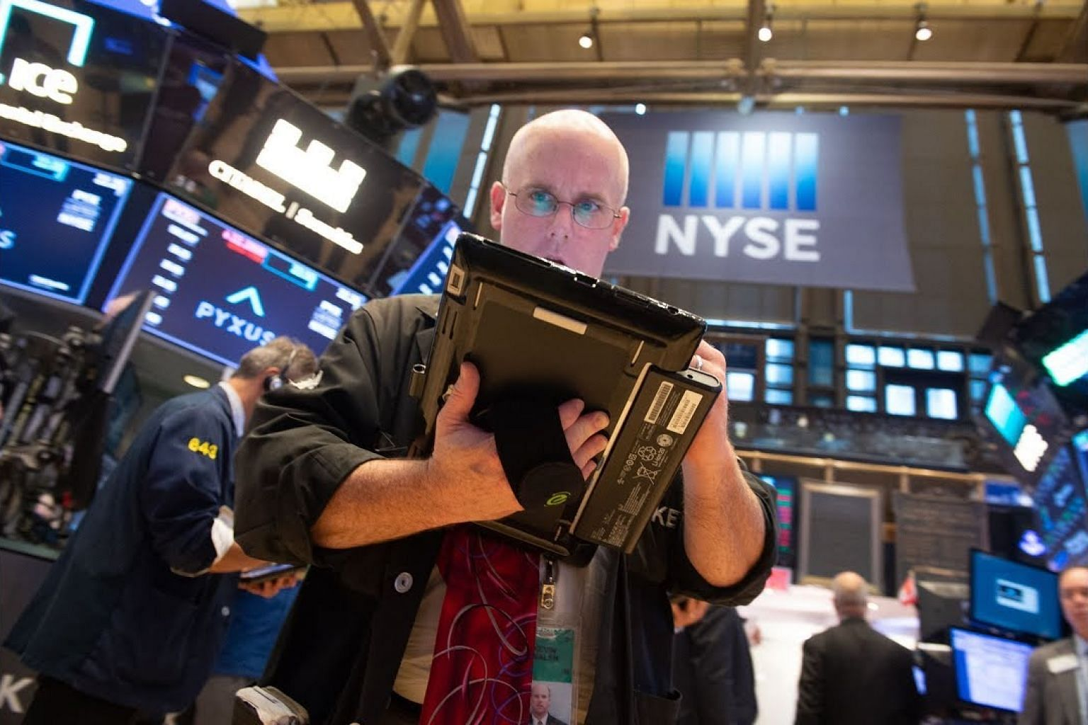 Wall Street rises with Apple