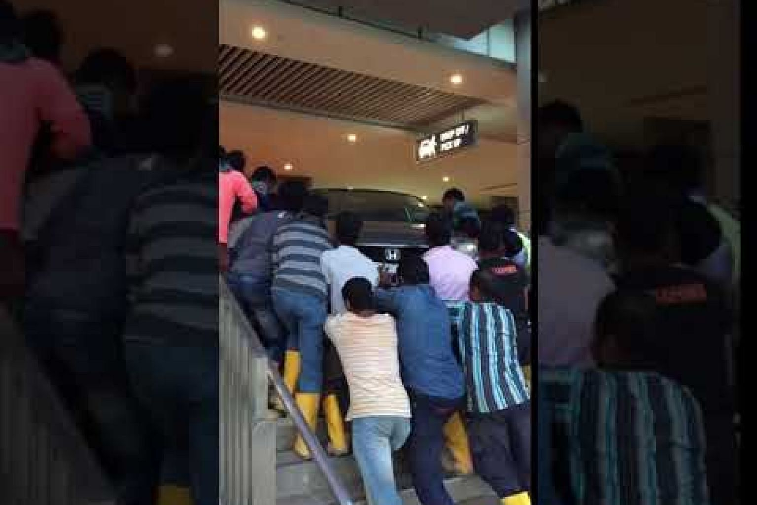 Over 10 foreign workers help push stranded car back on road