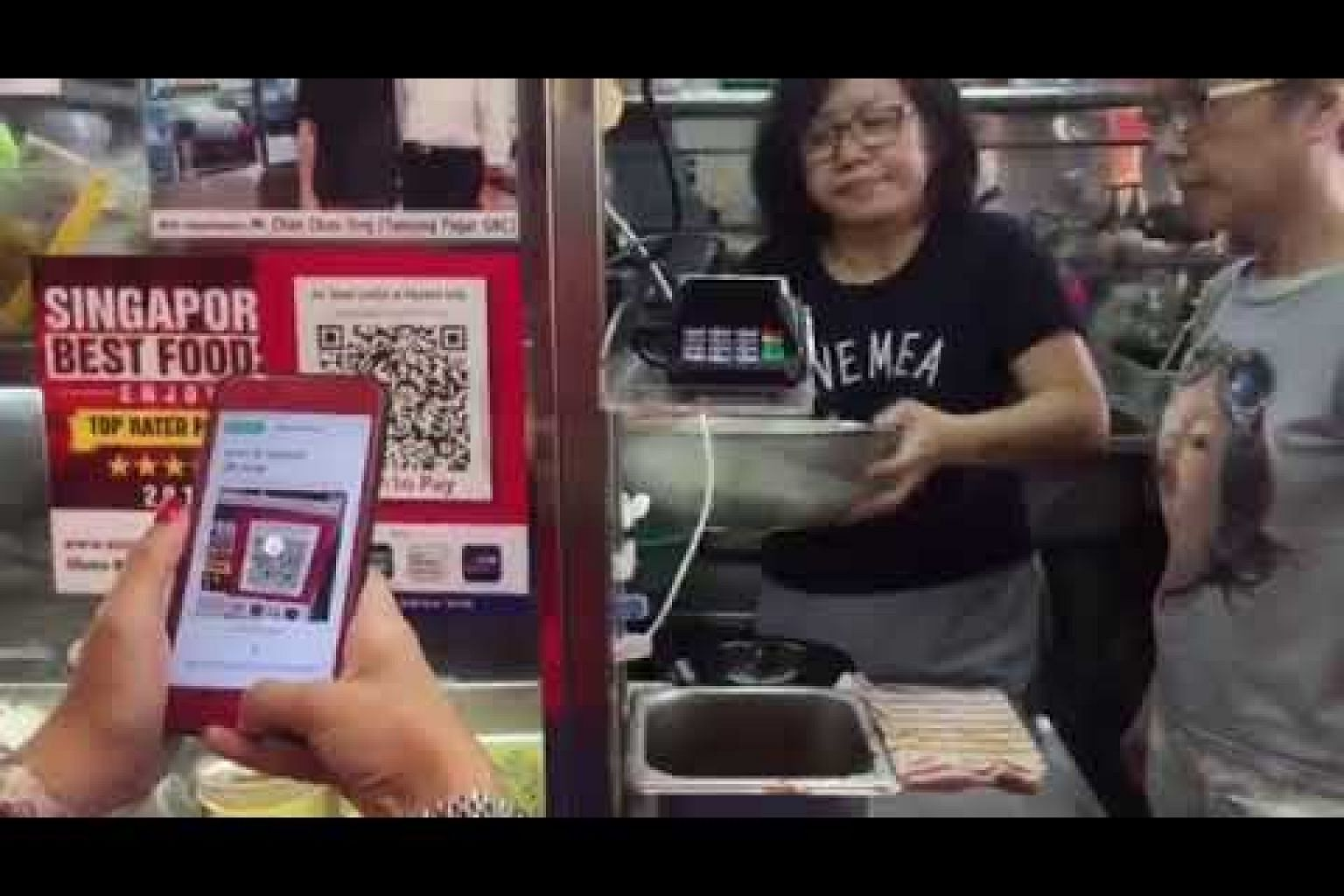 A customer scanning QR code to pay for meal