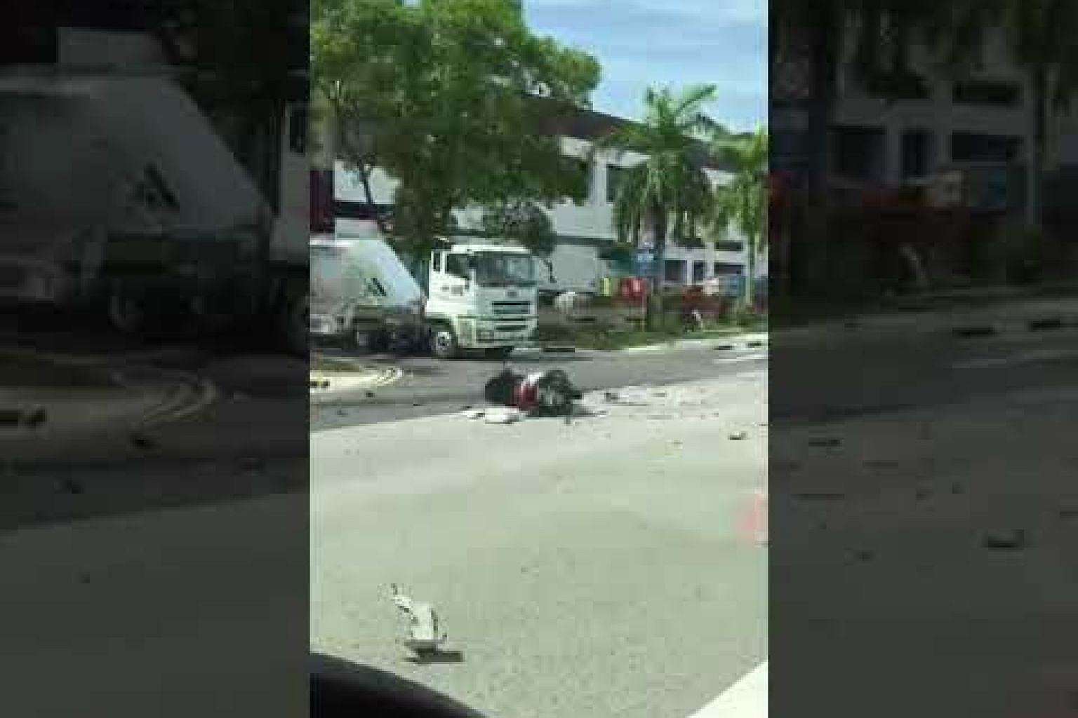 Accident involving trailer, lorry and motorcycle at Tuas West Road
