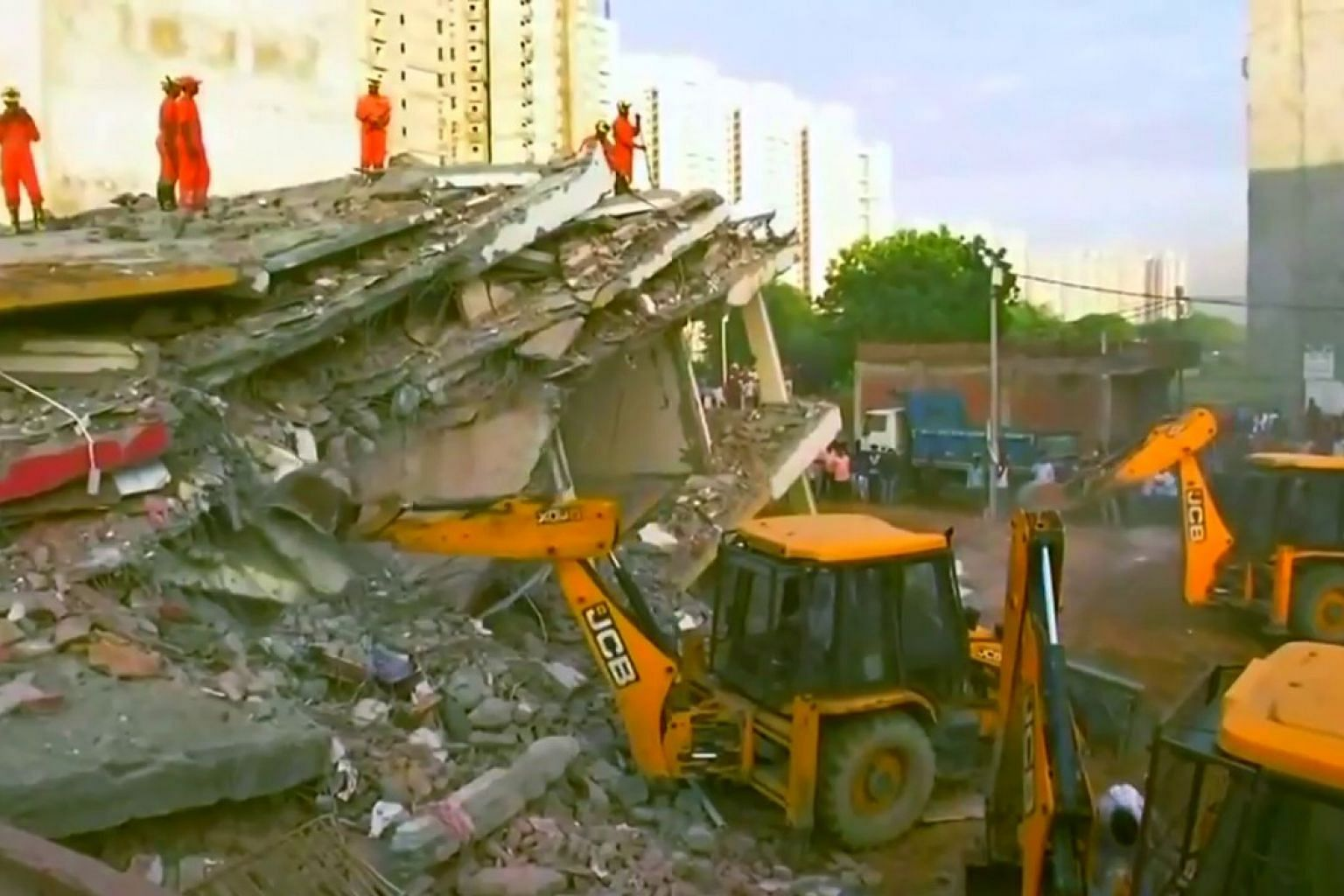 Rescuers scour rubble after apartment block collapses in India