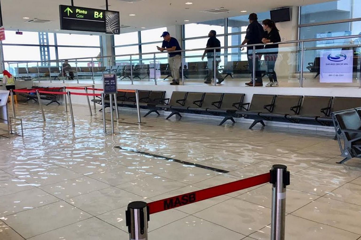 Penang airport flooded again - 'unusually heavy' downpour blamed