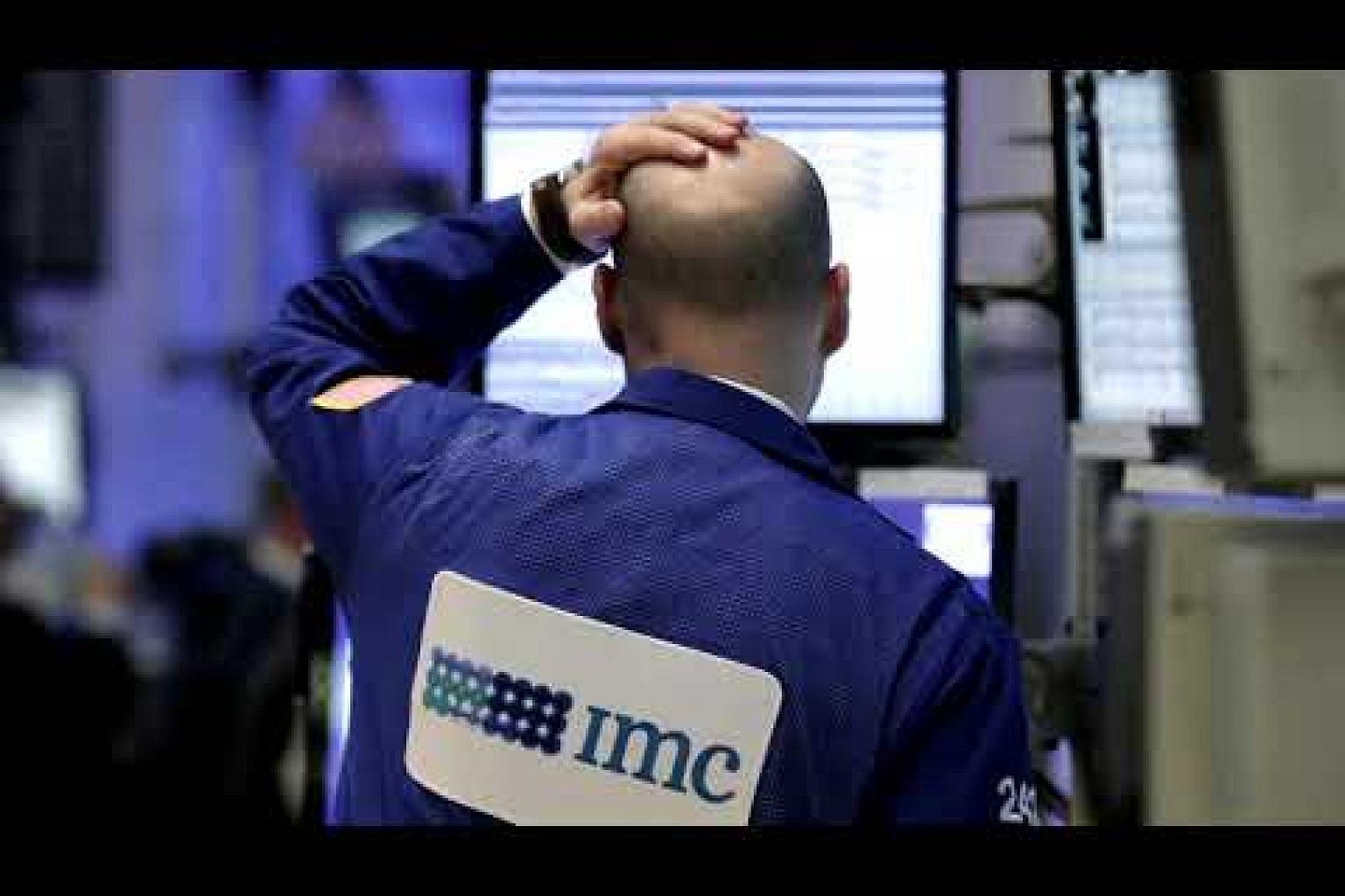Wall Street ends lower as tech stocks slide