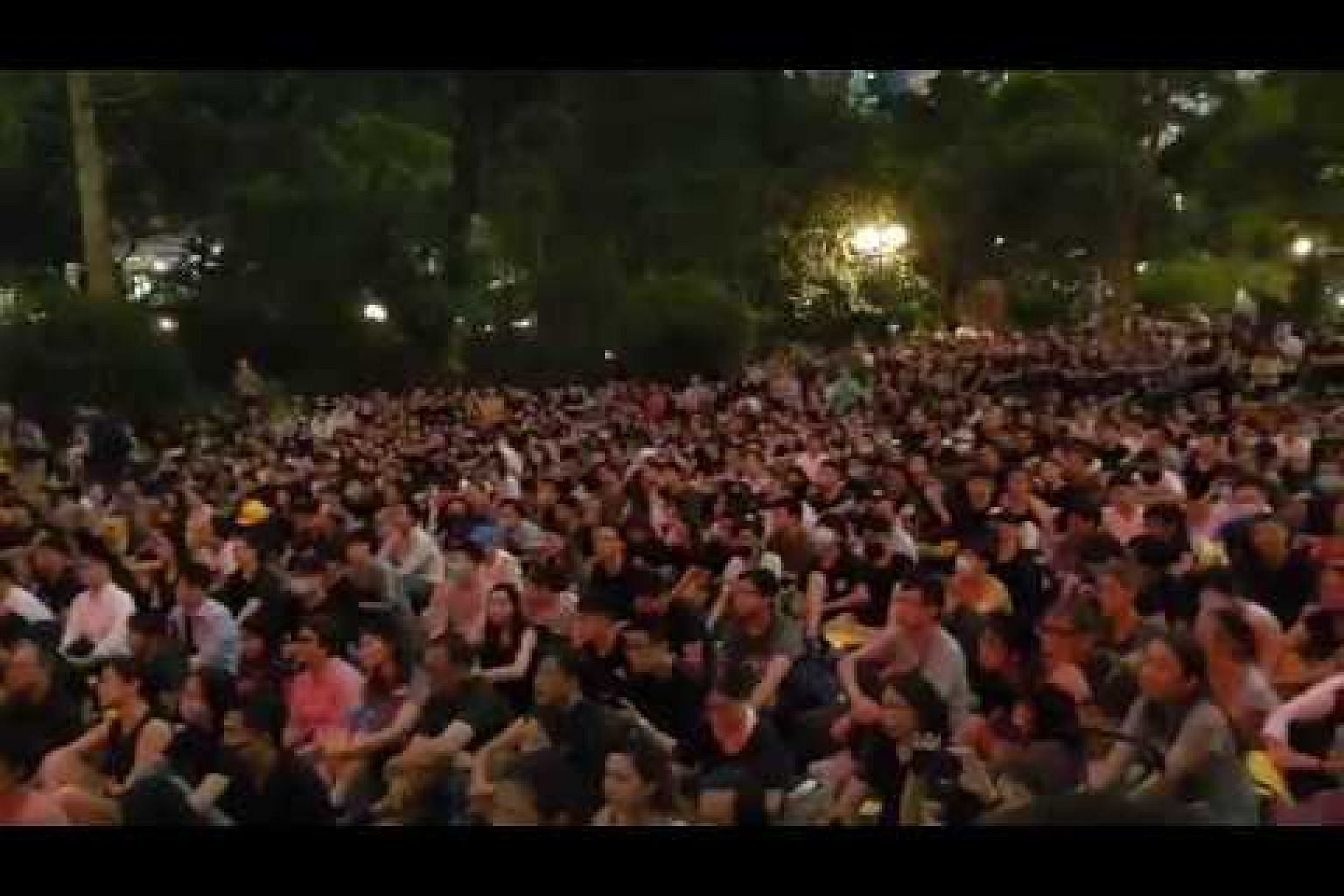 Protesters chanting 'liberate Hong Kong, revolution of our times'