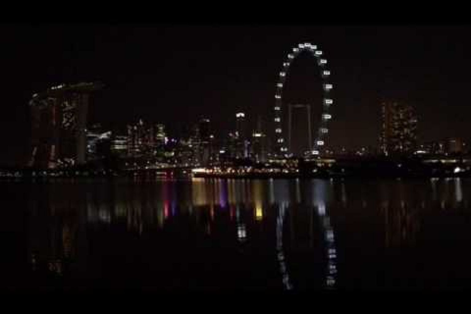 The Marina Bay skyline from 8.29pm to 8.31pm as Singapore marks Earth Hour.