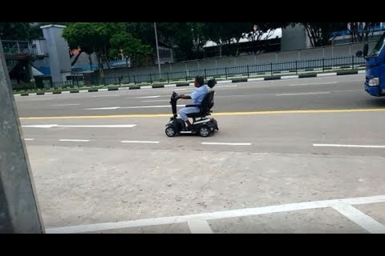 Man dressed in hospital gown seen using PMA on Eu Tong Sen Street near SGH