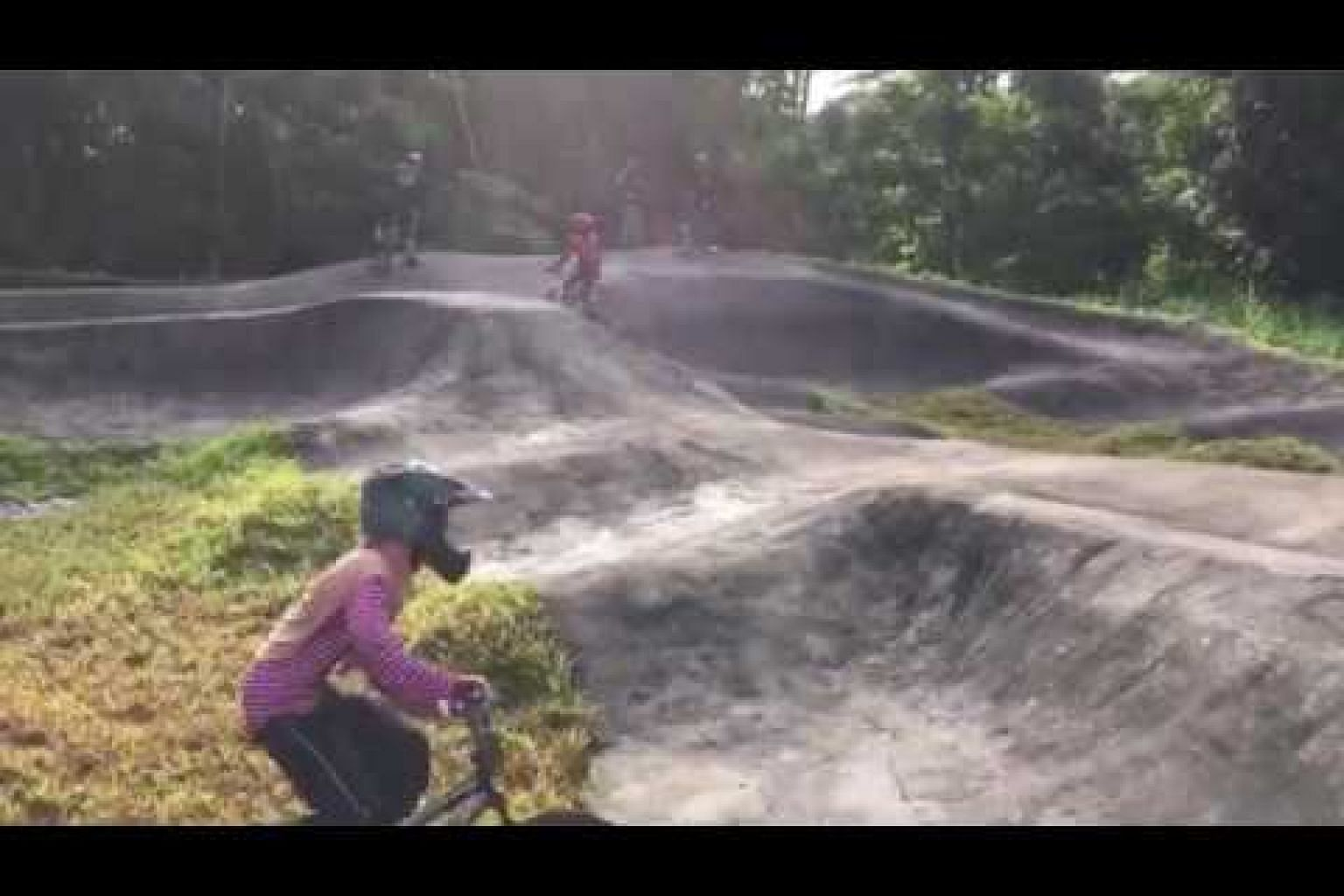 Bikers trying out the pump track, Singapore's first, at Chestnut Nature Park