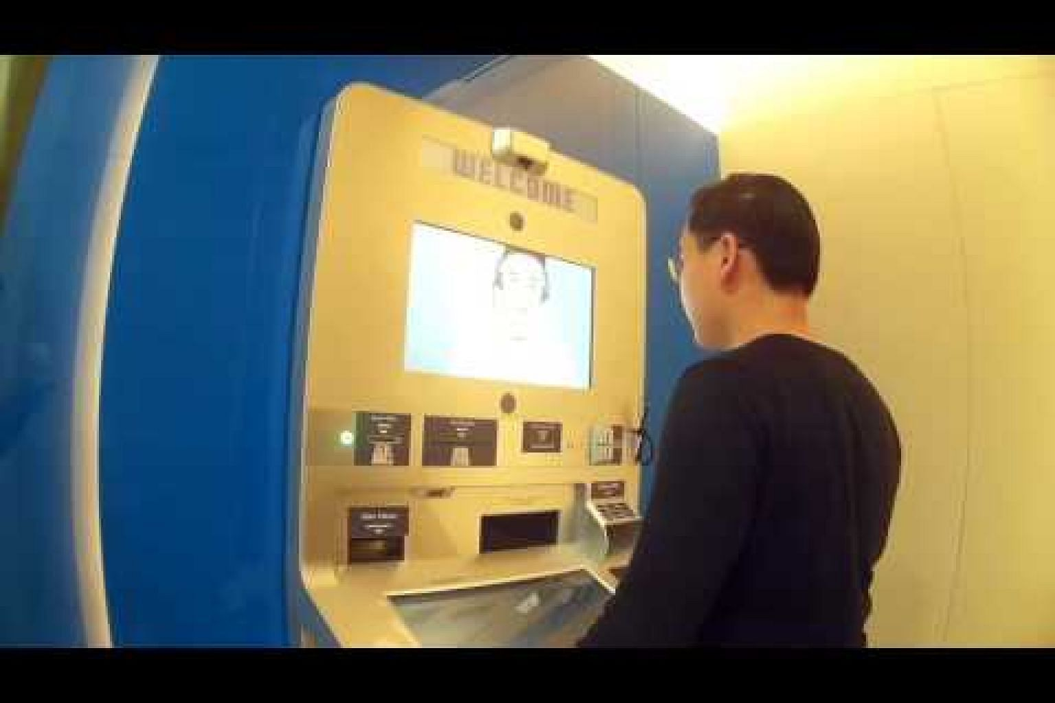 User trying the video teller machine
