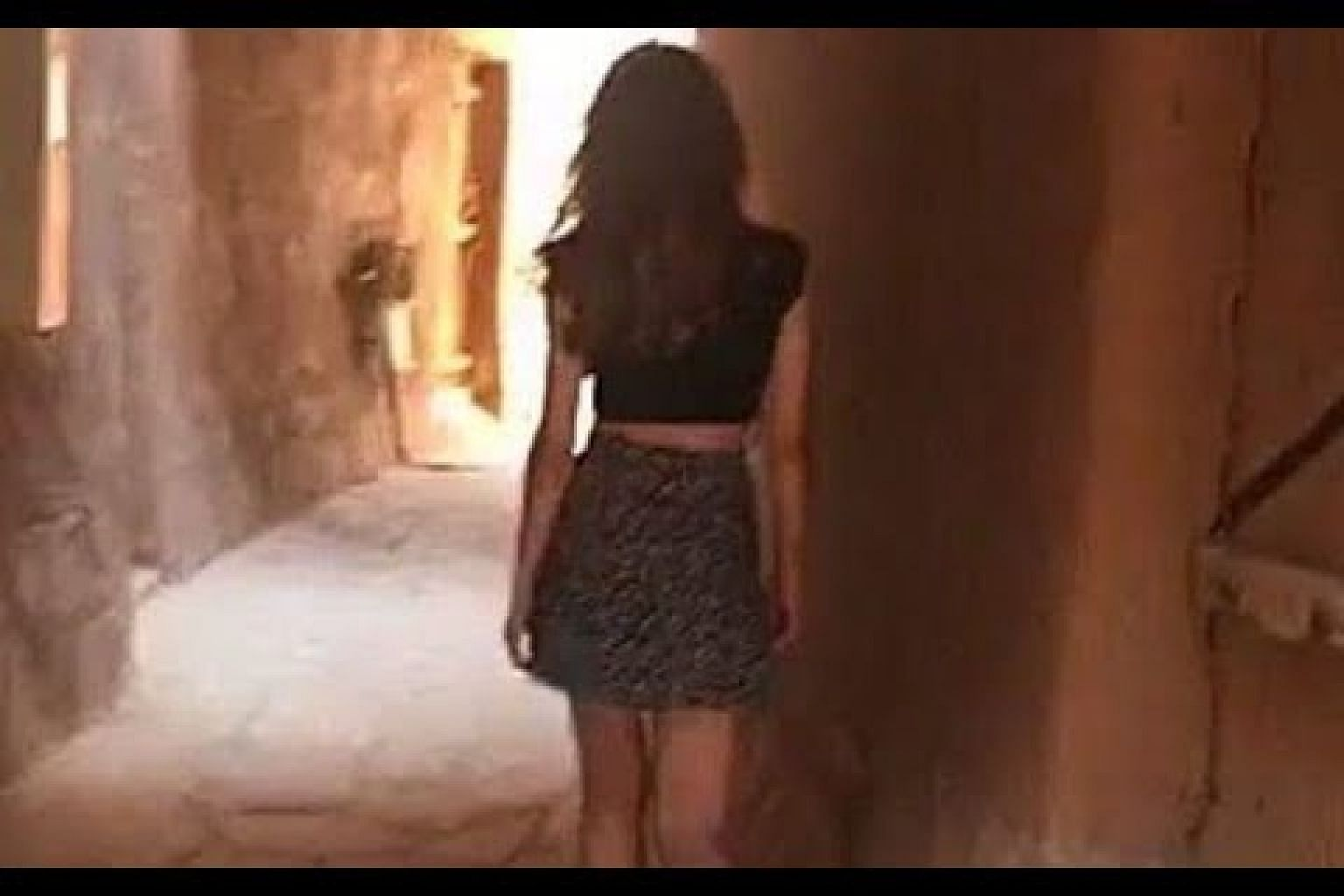 Video of Saudi Arabia woman in miniskirt.