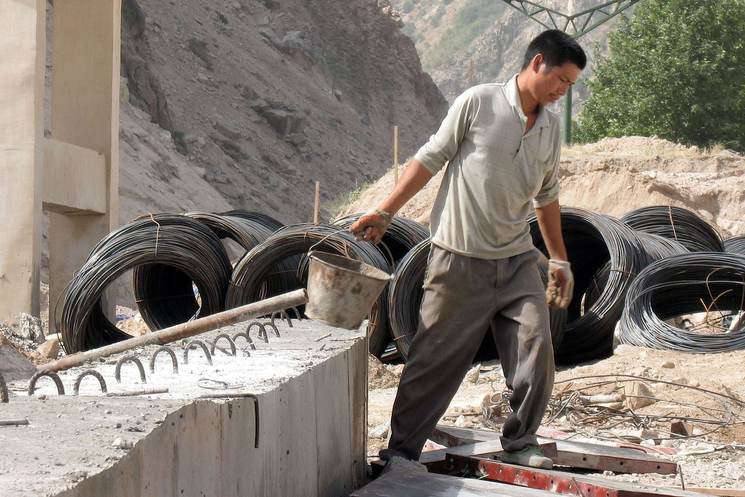 A Chinese worker at a road construction site between Dushanbe and Khujand in Tajikistan. The Central Asian country, once an outpost of the former Soviet Union, in increasingly dependent on China.