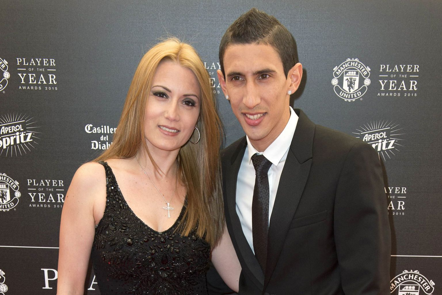 Argentina midfielder Angel di Maria and his wife Jorgelina posing on the red carpet as they arrived for United's Player of the Year Awards on May 19. Old Trafford fans have barely seen him at his best but after a single season, he is off to PSG to ch