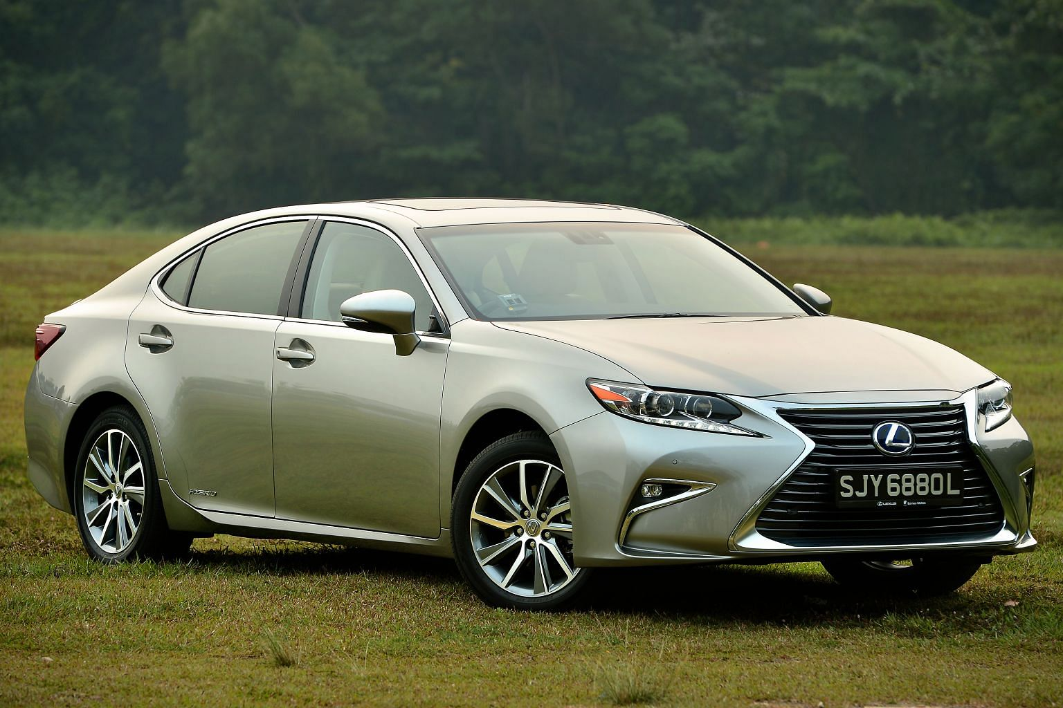 The Lexus ES Hybrid now looks sportier and its interior features more wood and leather.
