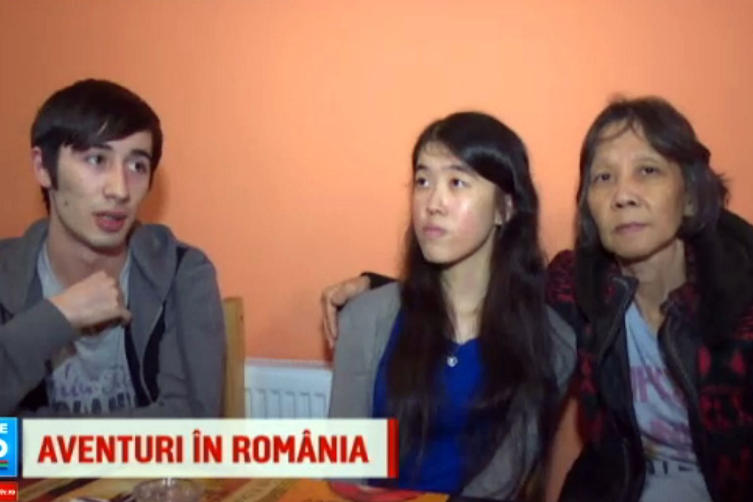 Above: Ms Cheryl Yap Lay Leng with her mother, Madam Foo Li Kheng, and her Romanian boyfriend Alexandru Donea in an interview with Romanian broadcaster Pro TV. Below: A photo of Ms Yap and her mother, flanked by police officers, was posted by the Rom