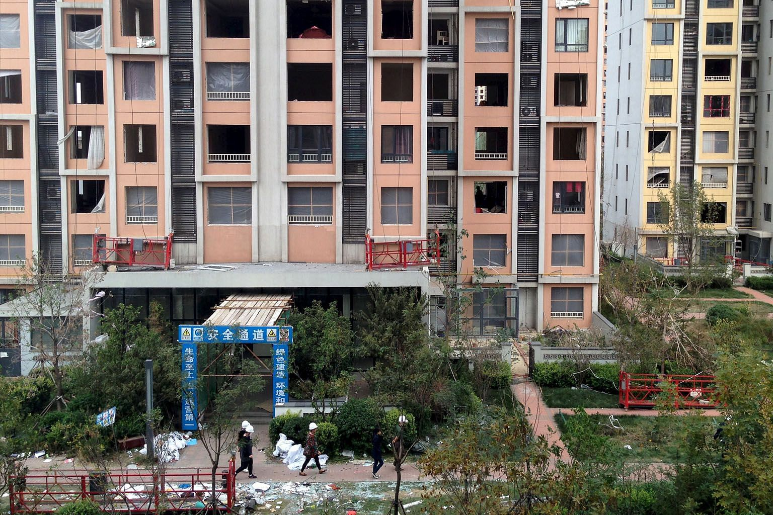 Last August's explosions killed 165 people in Tianjin and destroyed more than 300 buildings. Nearly 800 people were also injured.