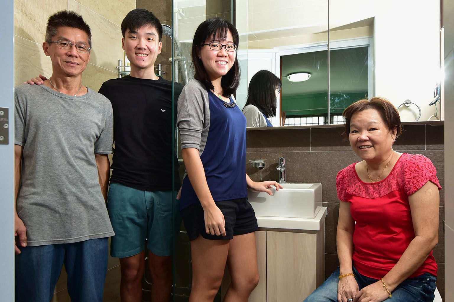 "Miss Jasmine See (third from left) with her dad Victor, brother Nicholas and mum Joyce in their renovated, ""hotel-concept"" bathroom."
