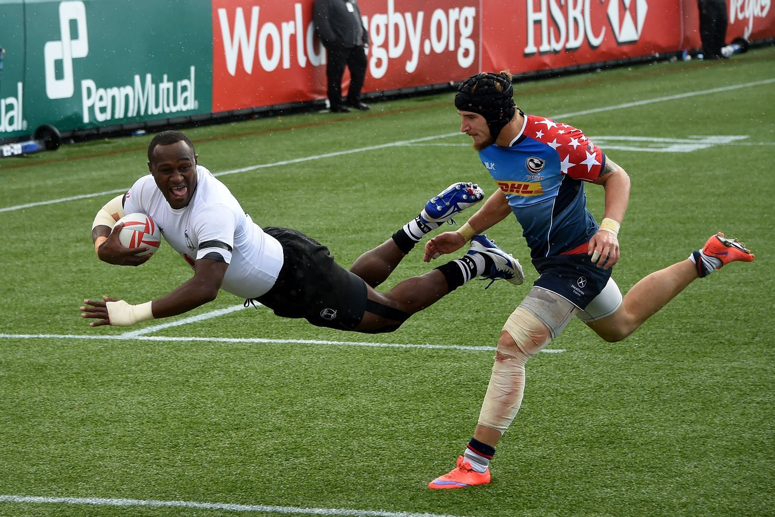 Pio Tuwai diving for a try as Garrett Bender of the US fails to stop him in their semi-final. Fiji beat Australia in the Las Vegas final.