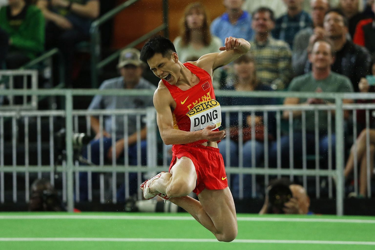 Dong Bin of China celebrates winning gold in the triple jump at the IAAF World Indoor Athletics Championships in Portland, Oregon on Saturday. He jumped 17.33m in the penultimate round to become only the third Chinese athlete to win a gold medal in t