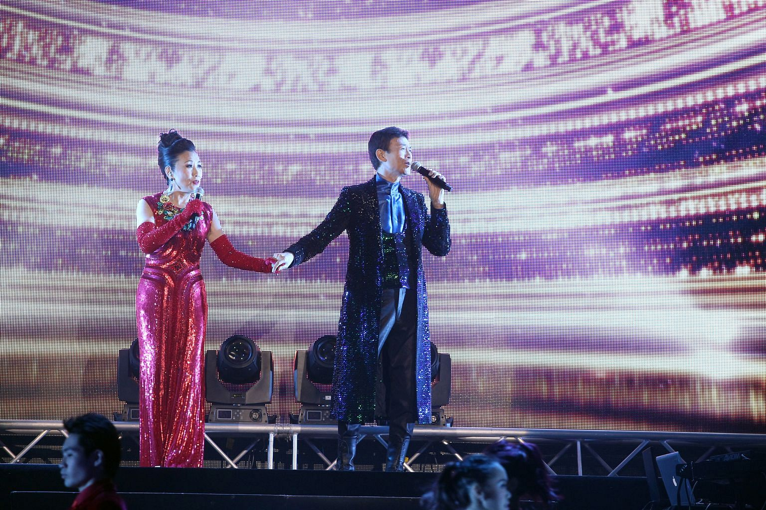Liza Wang will be performing with Adam Cheng at a concert here next month.