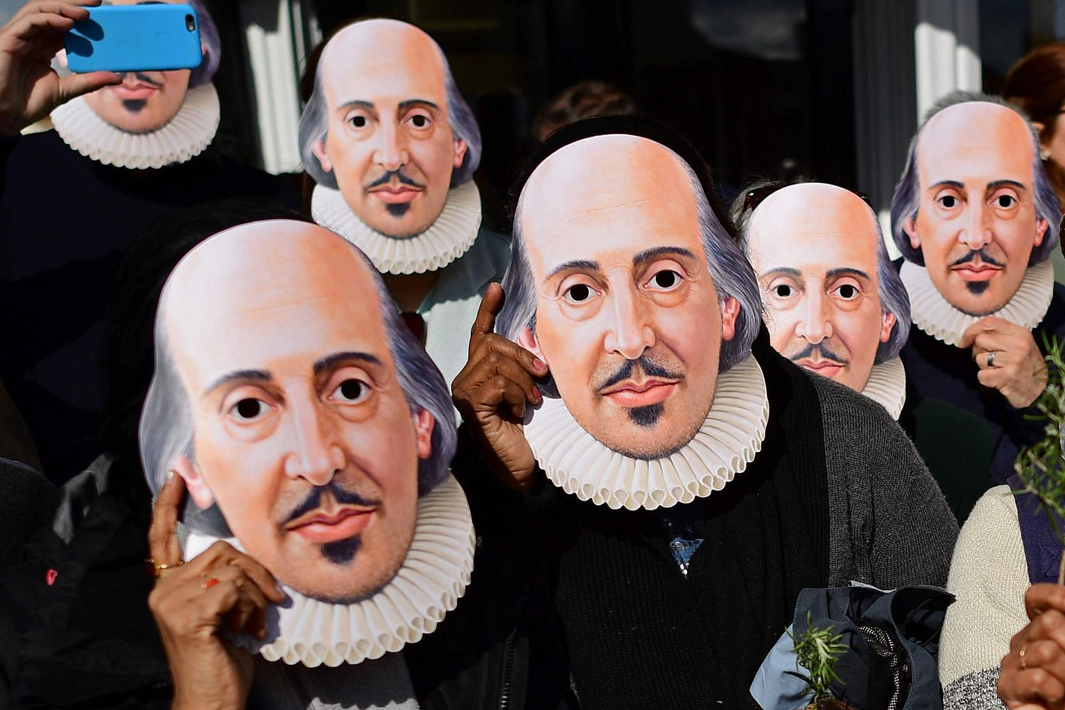"Members of the public wearing masks of the ""Bard of Avon"" to mark the 400th anniversary of William Shakespeare's death, in Stratford- upon-Avon in central England, in April."