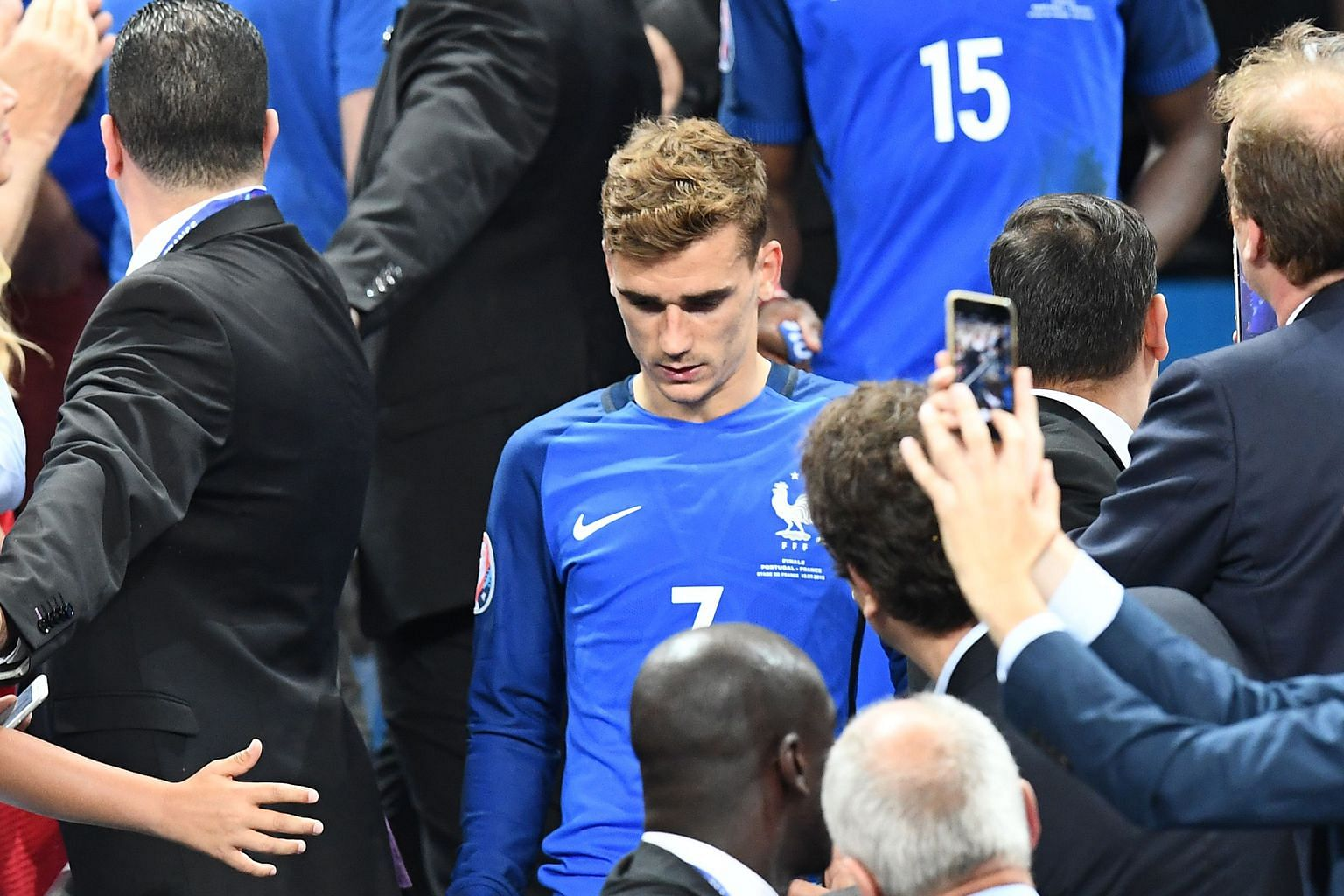 France forward Antoine Griezmann, who scored six goals at Euro 2016, shows his disappointment after the home side were beaten 1-0 by Portugal in the final at the Stade de France in Saint-Denis, north of Paris, on Sunday. Devastated French supporters