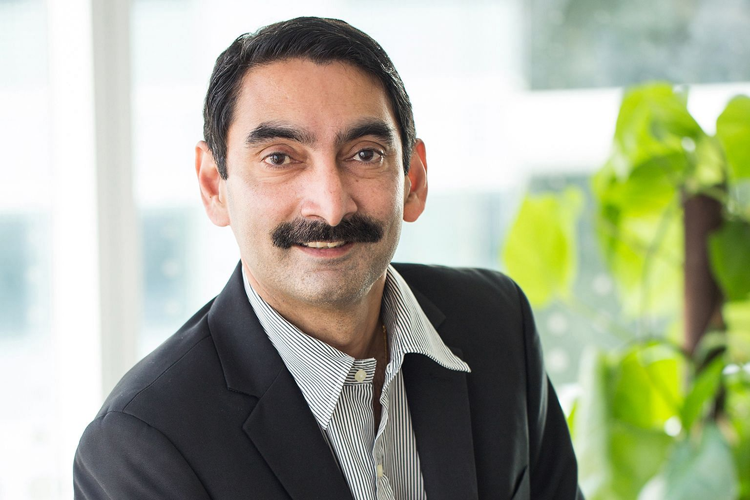 """Dr Thampuran is proud of how the work at A*Star and its dedicated team have grown the organisation to """"one of international standing"""". He has seen many of its young officers growing professionally to become leaders."""