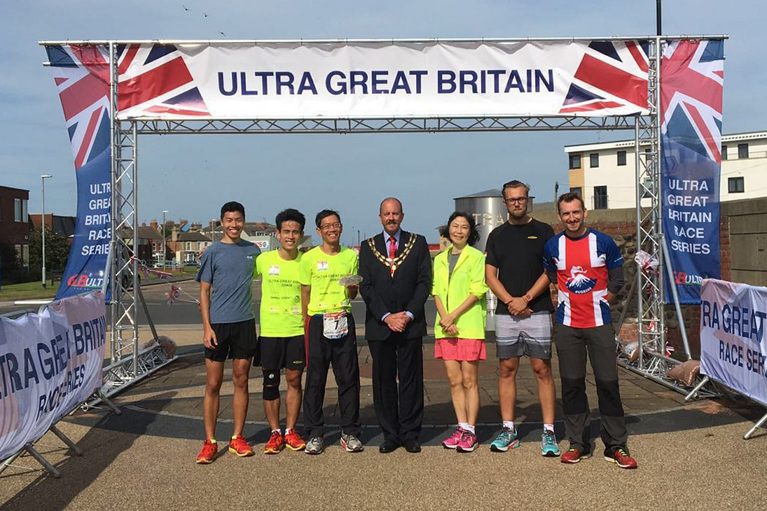 Mr Lim (third from left) at the finishing line on Tuesday with (from left) his son, Mr David Lim; his son's friend, Mr James Sng; Hornsea mayor Lee Walton; Mr Lim's wife, Ms Deborah Mok; Mr Lim's British physician, Dr Tomas Wally; and race director M