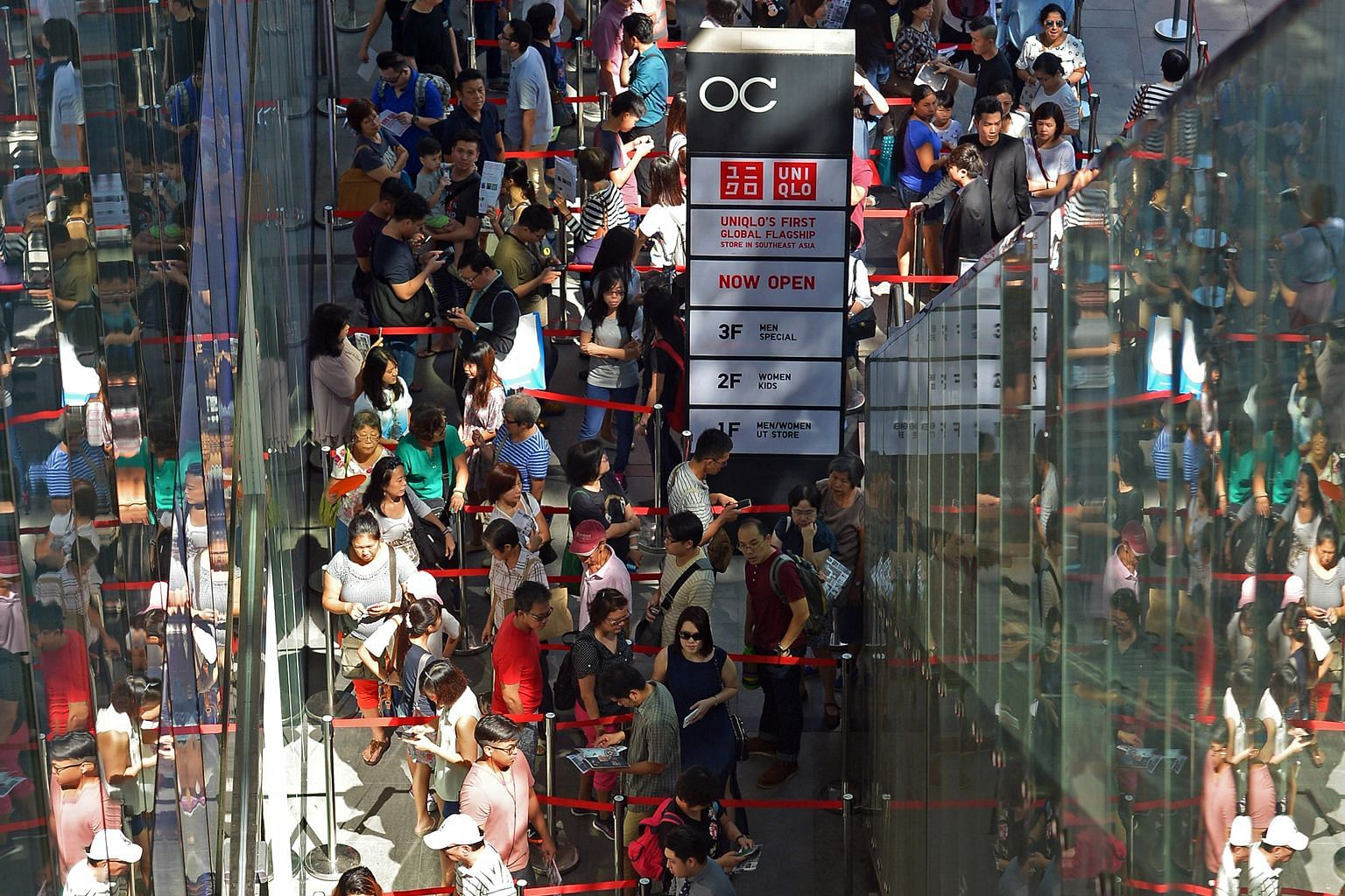 People waiting to get into the Uniqlo flagship store at Orchard Central yesterday.