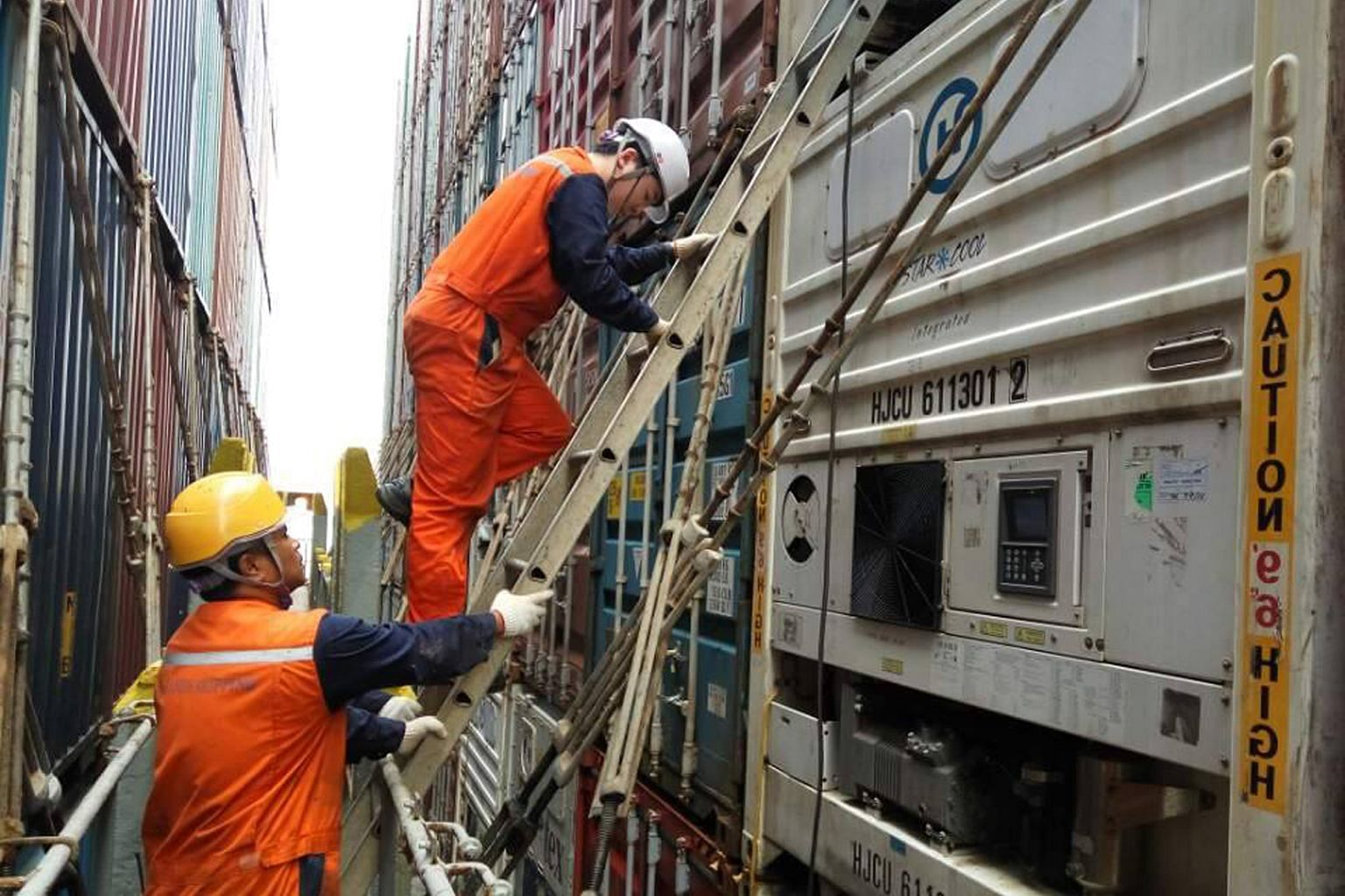 Crew members going about their daily jobs on board the Hanjin vessel. Here, they are checking on the condition of reefers or refrigerated containers, which are typically used to store food or fresh produce. These containers have to be monitored at le