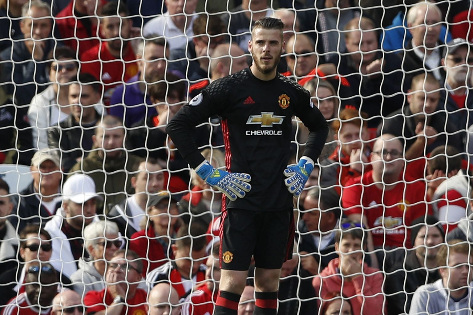 A dejected- looking United goalkeeper David de Gea, whose fumble led to Stoke's equaliser at Old Trafford late in the game. Anthony Martial had given the home team the lead with his first goal of the season. The point moved Stoke up into 19th spot wh