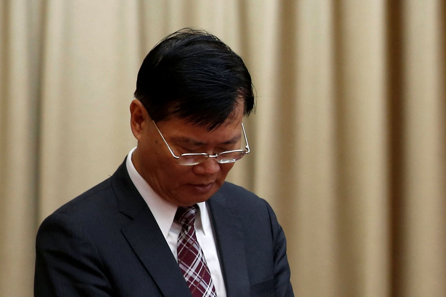 Mr Ding says he resigned to maintain his innocence and end damage to the financial watchdog.