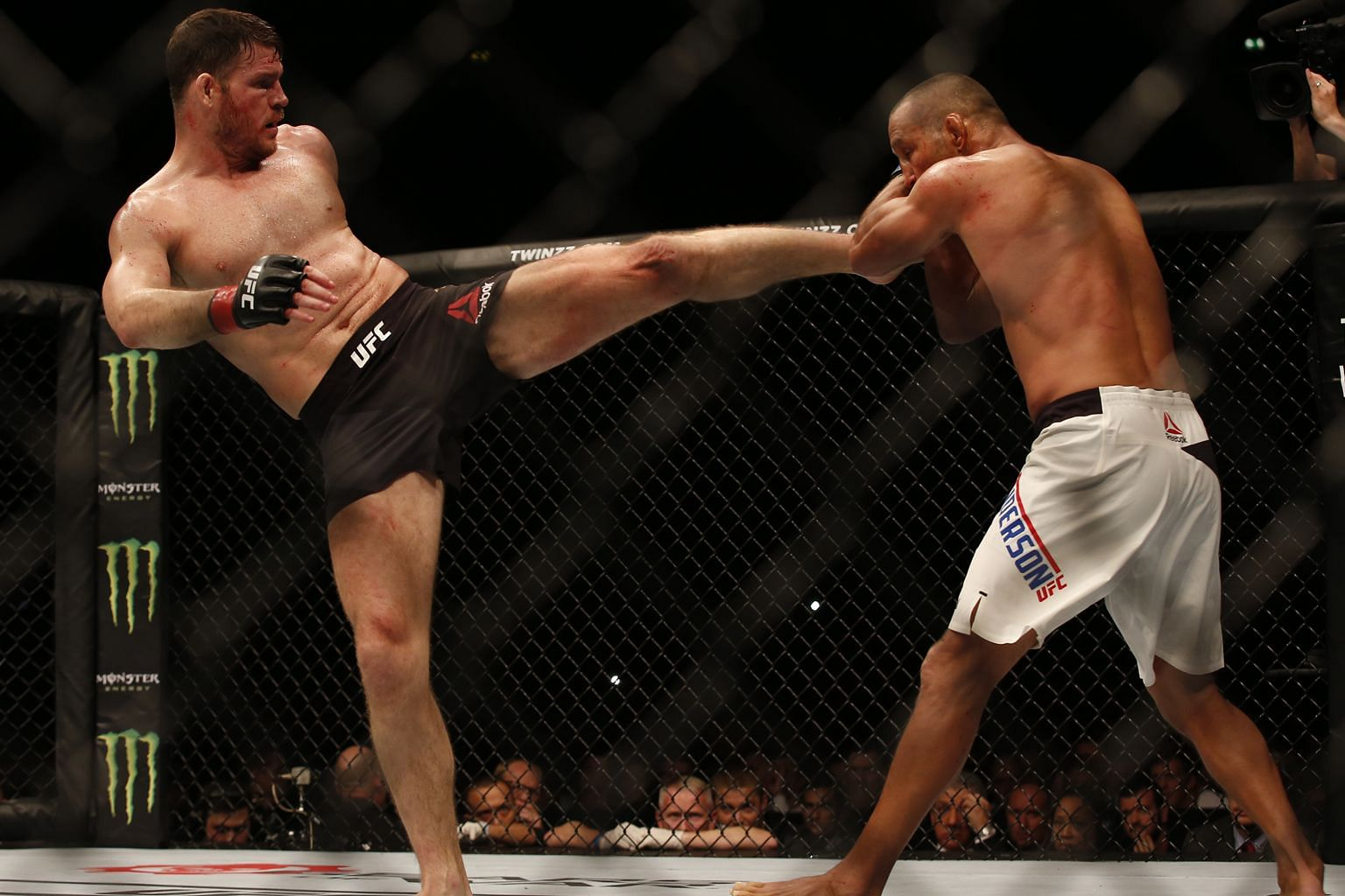 Michael Bisping kicking Dan Henderson during the bout, which all three judges gave to the middleweight defending champion. This was the 46-year-old Henderson's final pro fight.