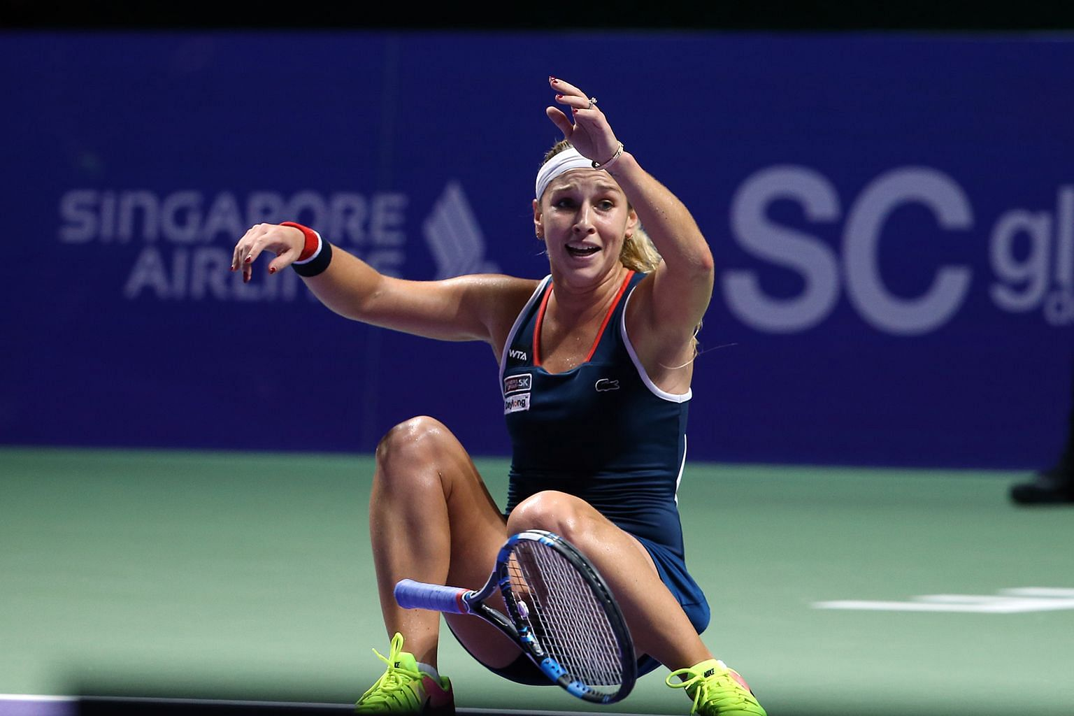 Overcome by emotion, Dominika Cibulkova collapses on the court after her unexpected but decisive 6-3, 6-4 victory against Angelique Kerber in the WTA Finals at the Singapore Indoor Stadium yesterday.