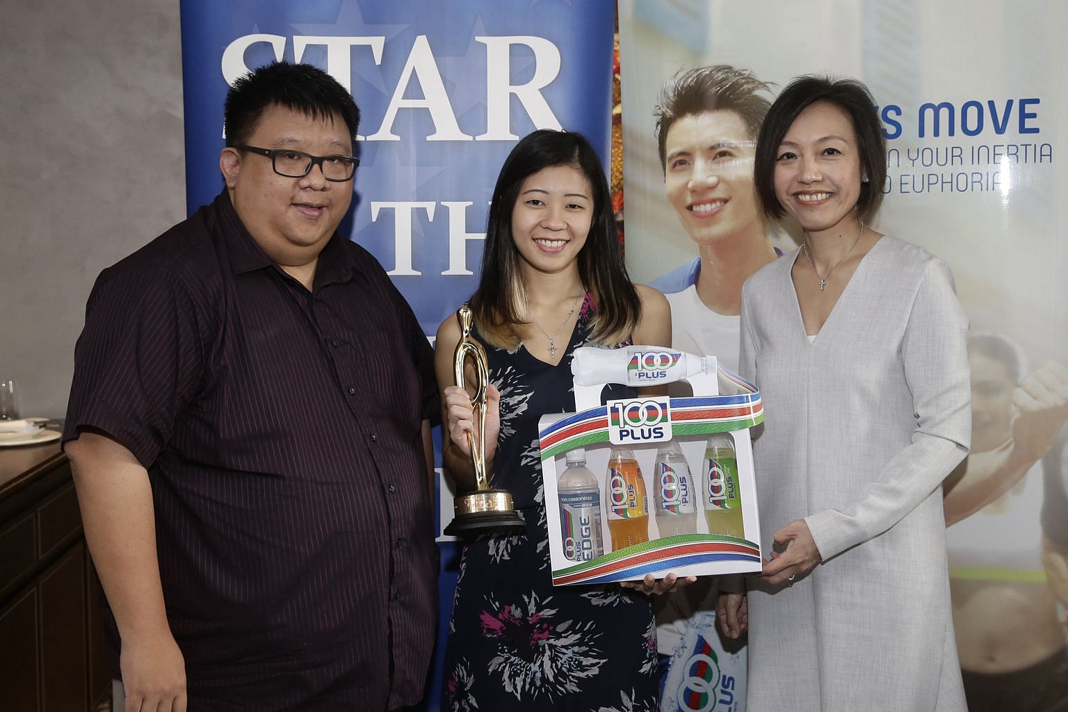 Bernice Lim (middle), the ST Star of the Month for October, with ST's assistant sports editor Chia Han Keong and Jennifer See, the general manager of F&N Foods Singapore.