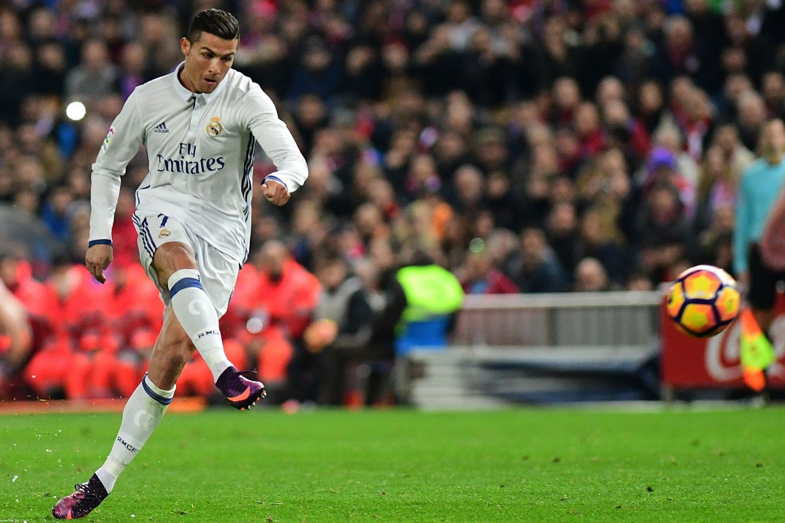 Cristiano Ronaldo opening accounts for Real with this free kick. His second-half penalty and tap-in took his derby tally to 18 goals and stretched the team's lead over second-placed Barcelona to four points.