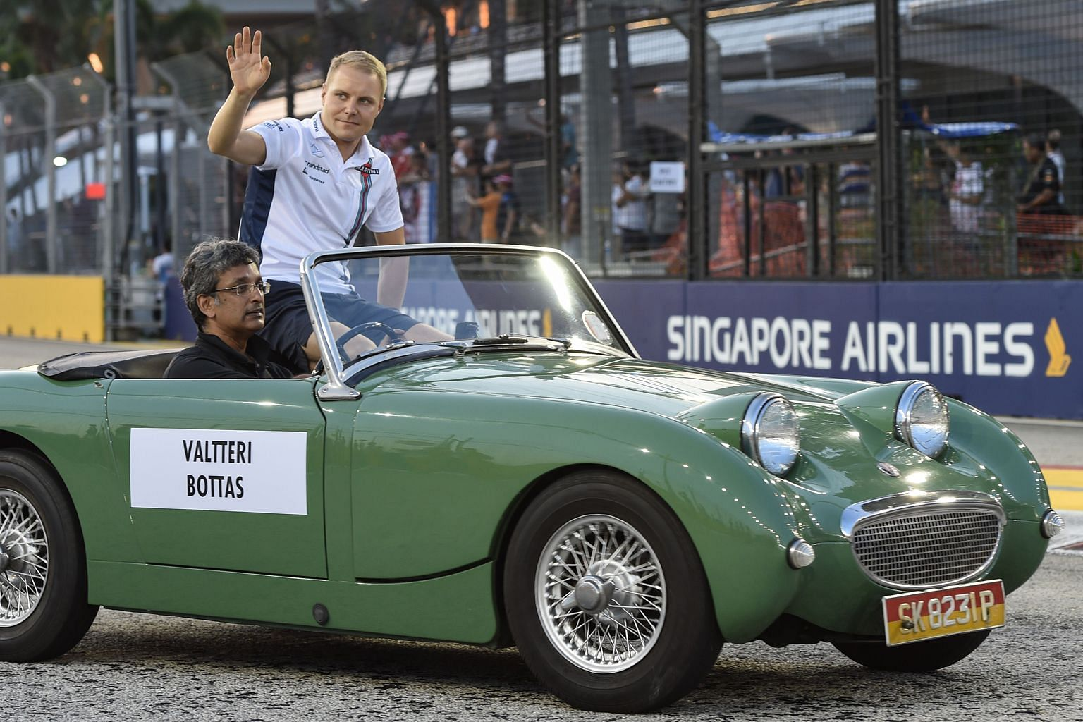 Valtteri Bottas at the drivers' vintage car parade before the Singapore race. He would be an acceptable team-mate for Hamilton.