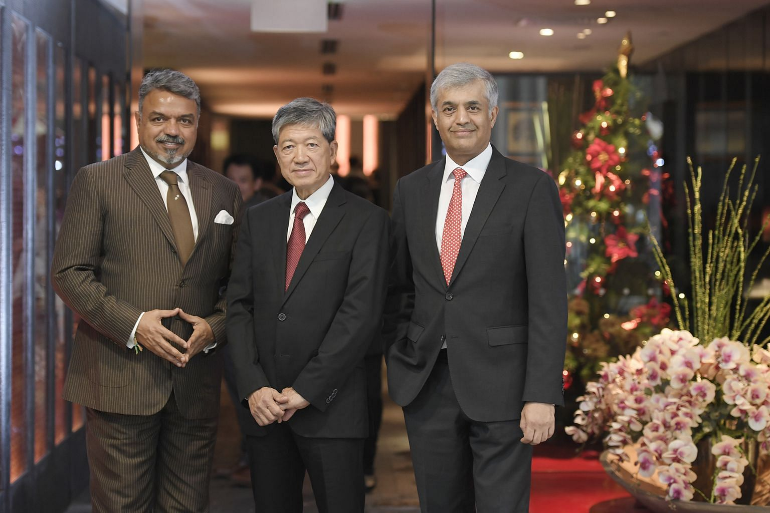 (From left) Mr Ravi Thakran, chairman and managing partner of L Catterton Asia, Mr Ip Yiu Tung, founder of Crystal Jade Culinary Concepts Holdings, and Mr Nainesh Jaisingh, global head of principal finance at Standard Chartered Bank, at Crystal Jade'