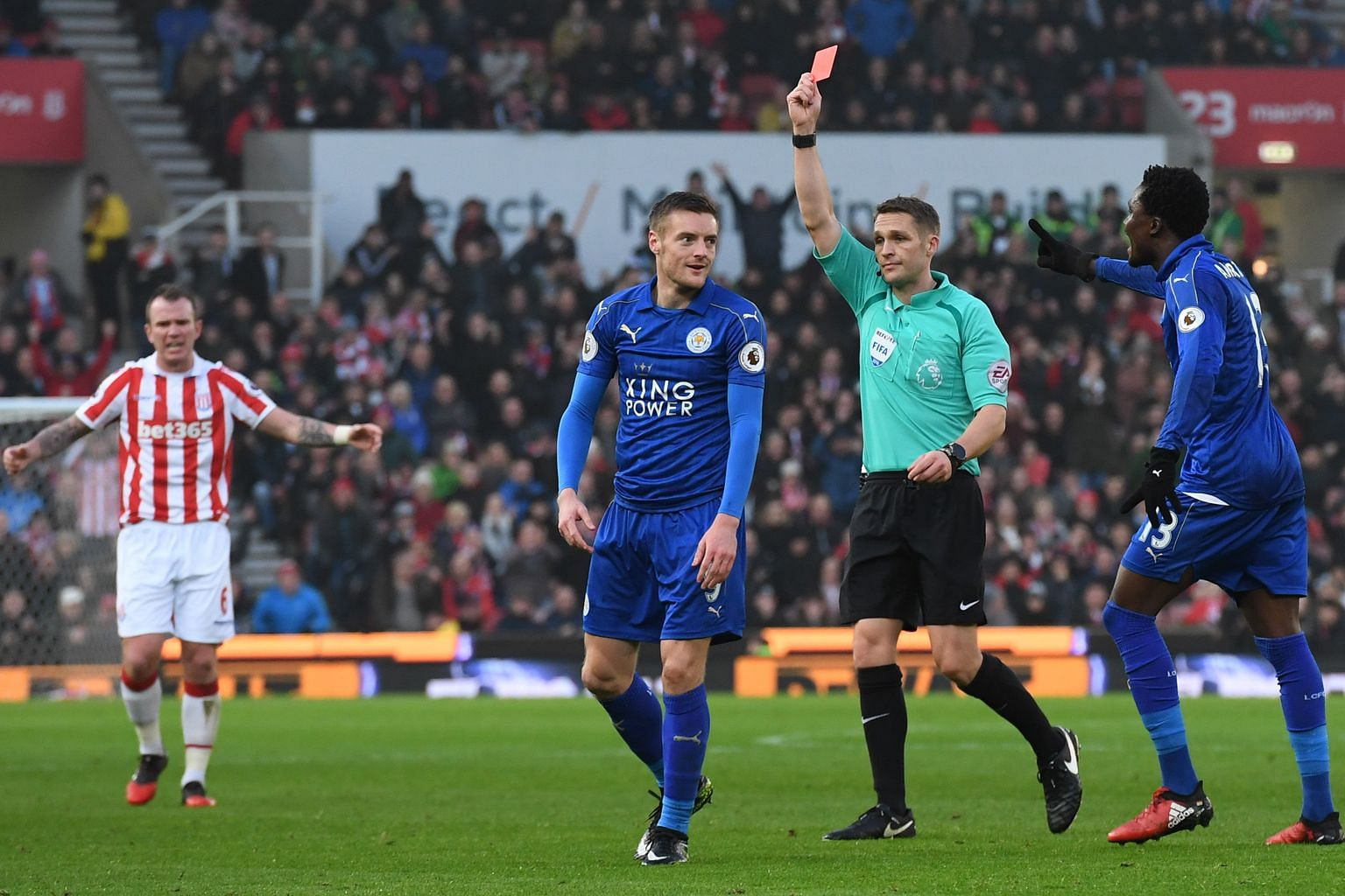 Jamie Vardy (left) being sent off by referee Craig Pawson for a two-footed lunge at Stoke City's Mame Biram Diouf.