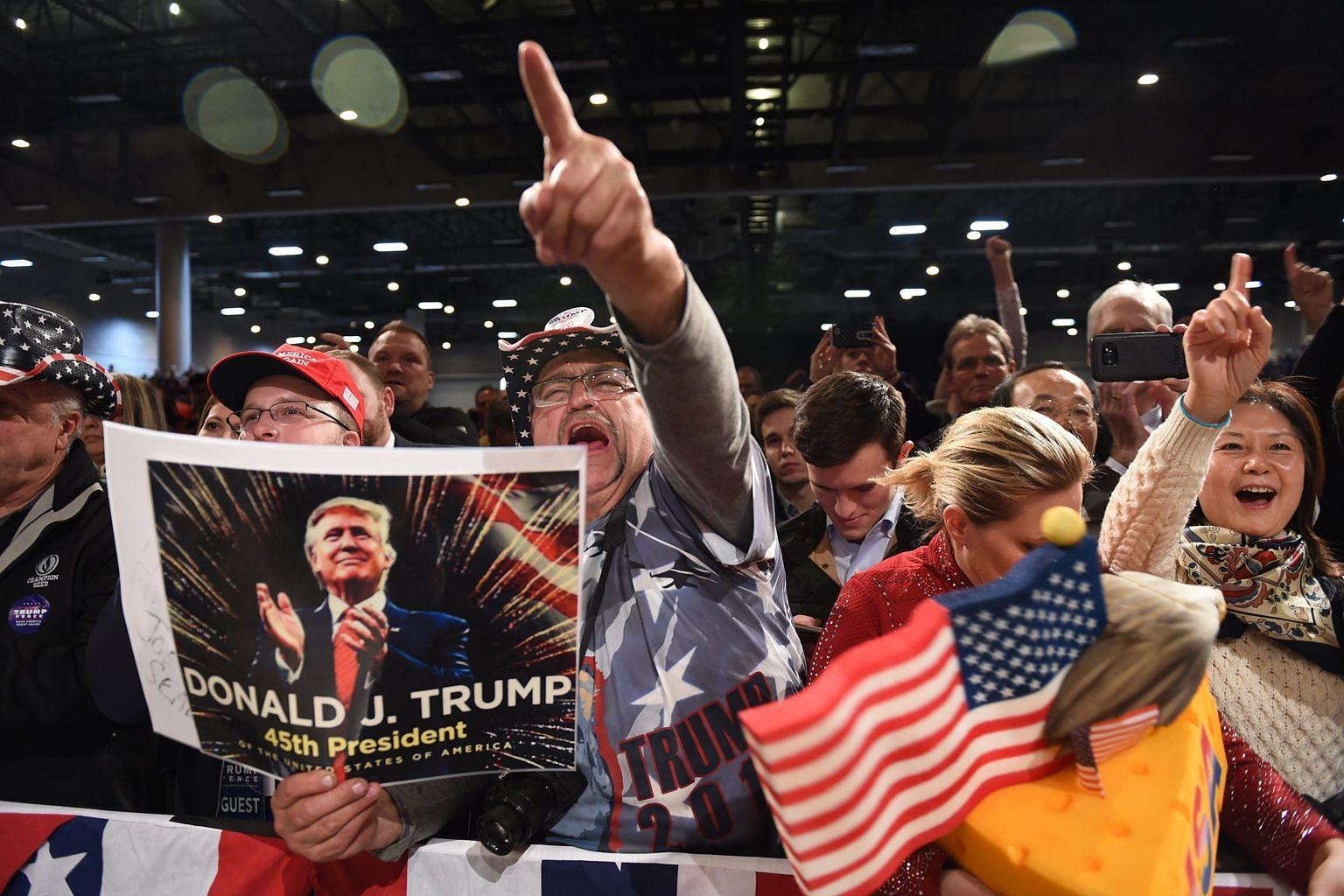 """Supporters in Des Moines, Iowa, cheering during US President-elect Donald Trump's """"Thank-You"""" tour last month. To rural Americans, it seems their taxes mostly go to making city residents live better. They also think the liberal worldview creates unne"""