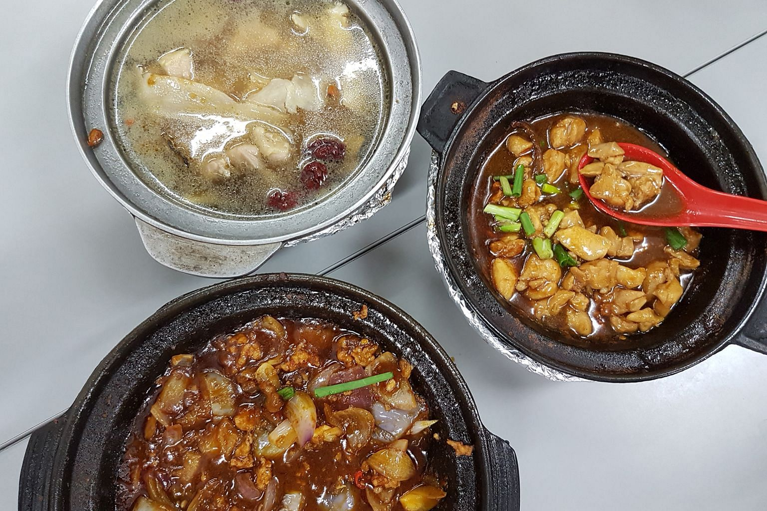Clockwise from top left: herbal chicken soup; sesame oil chicken; and eggplant and minced meat.