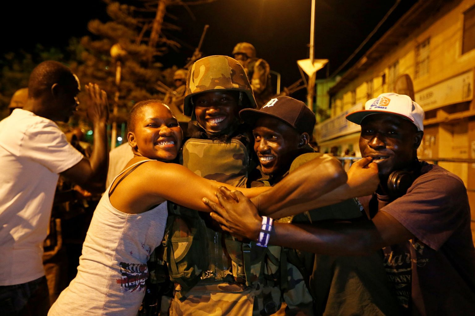 Former president Mr Jammeh, who ruled for 22 years, finally ceded power and left Gambia on Saturday. Residents of the Gambian capital of Banjul celebrating the arrival of West African forces on Sunday. The Economic Community of West African States de