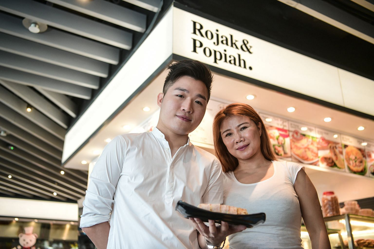 Mr Popiah's Madam Li and her son Lewis at their branch in Ang Mo Kio Hub. They are looking into further automating the popiah-making process. Currently, Mr Popiah is 70 per cent automated. The firm aims to achieve automation in Singapore and China by