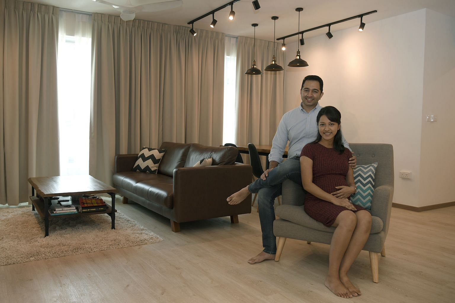 Above: For Mr Nair and Ms Pandit, who are expecting their first child, buying a spacious home was a priority as they wanted their child to have the space to crawl about and run around in. Their 1,200 sq ft five-room flat in Clementi cost about $630,0