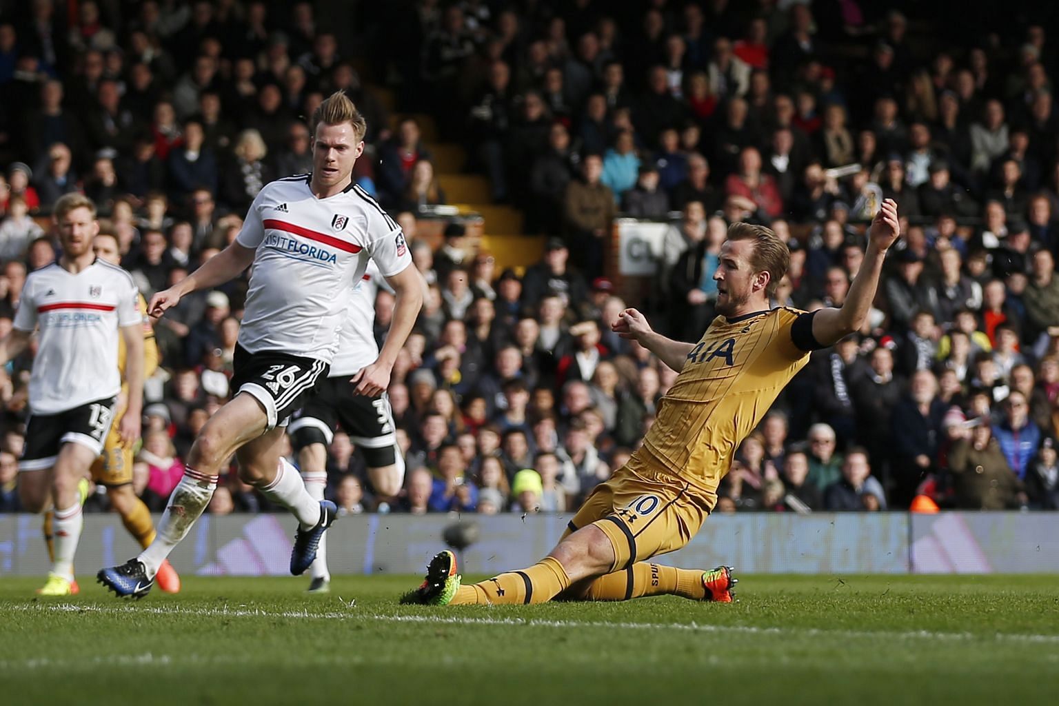 Tottenham's Harry Kane sliding in to open the scoring against Fulham in the 16th minute, after Christian Eriksen had placed the ball on a platter for the England striker. The Spurs duo repeated the combination in the 51st minute as Kane buried anothe