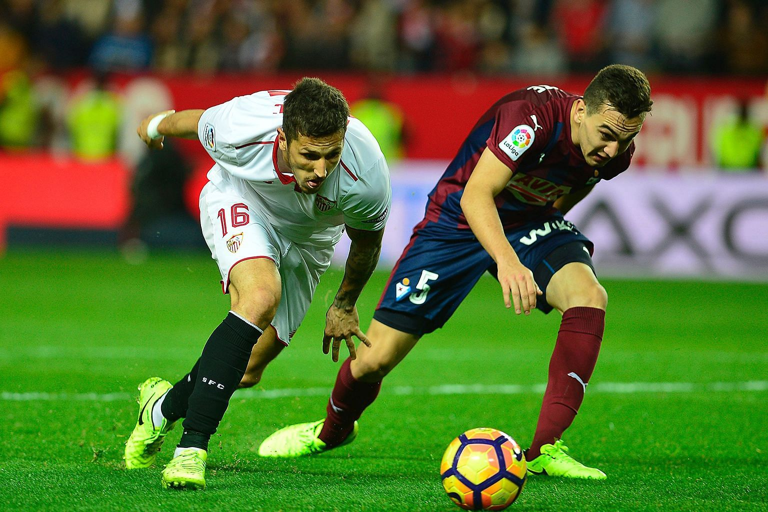 Sevilla's Stevan Jovetic (left) holds off Eibar's Gonzalo Escalante during their La Liga match on Saturday. The Montenegrin scored twice in his first two games for the Europa League winners, and his form will be a factor for Leicester City to take in
