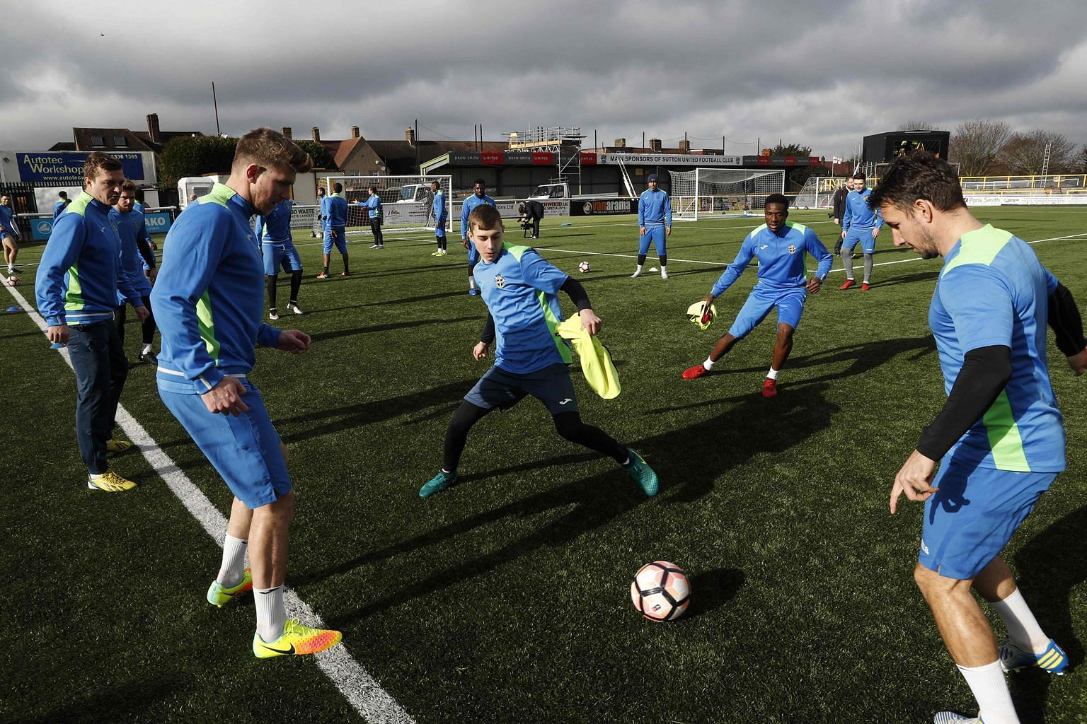Sutton players in a drill during a training session ahead of tonight's FA Cup fifth-round clash against mighty Arsenal. The Gunners are at their most vulnerable level in years but Arsene Wenger has promised to pick a strong team as Sutton sense argua