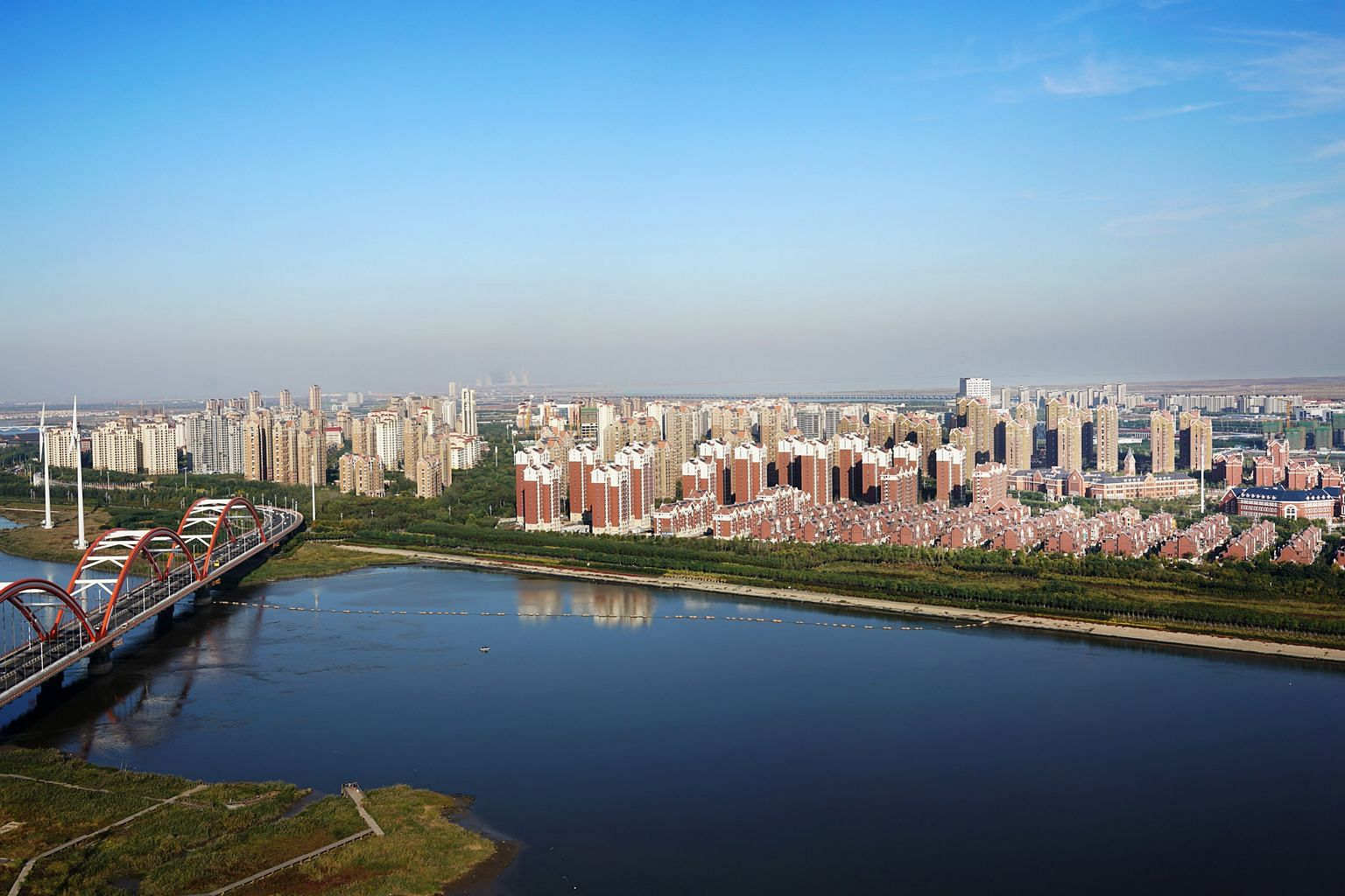 The Keppel conglomerate's involvement in the Tianjin Eco-City (above) and CapitaLand's role in Guangzhou's Datansha island project (left) have been cited as overseas examples of local industry players' track records, as they eye a master- developer m