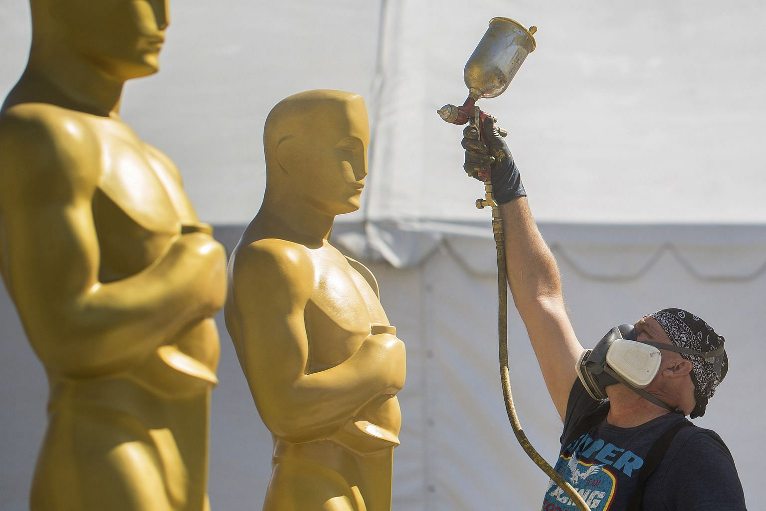 Stage craft artist Rick Roberts giving Oscar statues a fresh coat of paint in preparation for the 89th Academy Awards in Los Angeles today (tomorrow, Singapore time).