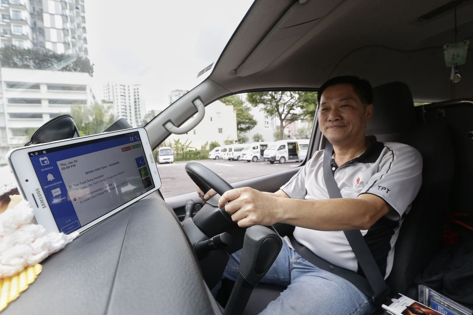 Handicaps Welfare Association van driver Ng Song Liang uses the HeartWheels app to view his schedule from a tablet, instead of depending on a pen and paper method and picking up phone calls from the office.