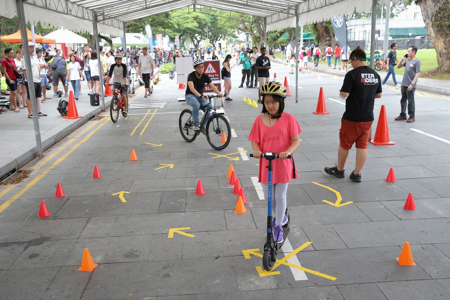 Participants had a hands-on preview of the Safe Riding Programme yesterday at a Car-Free Sunday event in the Civic District. The course, which will be free for the first year, will be rolled out at selected community centres, schools and migrant work