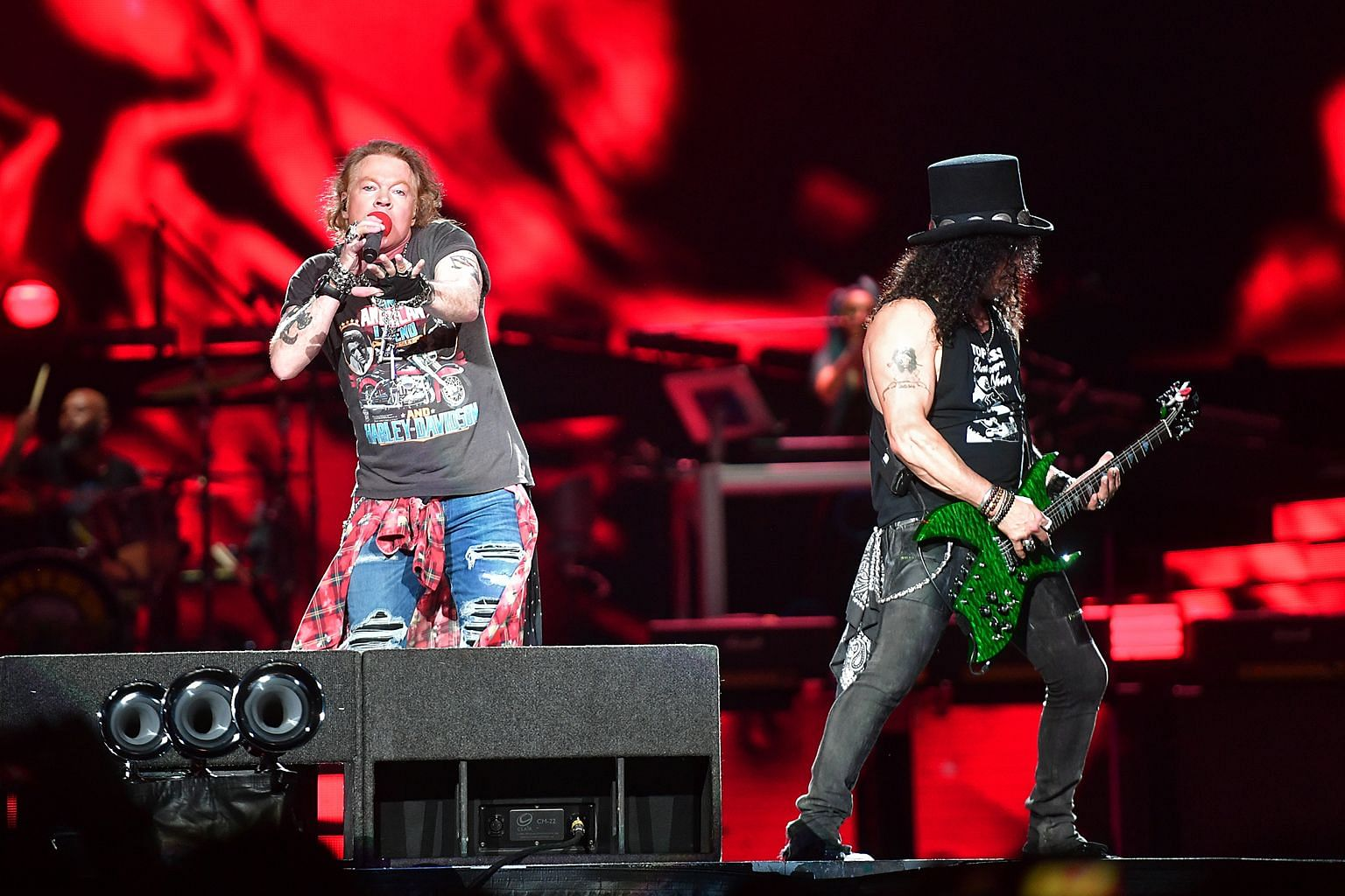 Guns N' Roses' frontman Axl Rose and guitarist Slash (both above) heating up the stage.